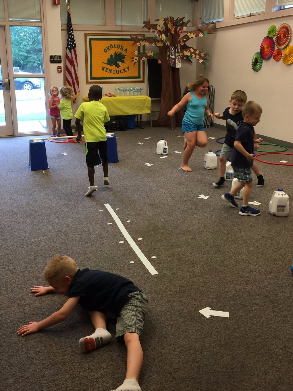 Campers enjoying an indoor obstacle course at Okolona library